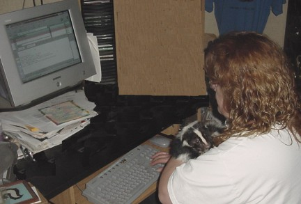 Photo of Cathy Dalgliesh and one of her skunks